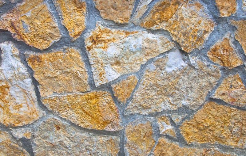 Hauswand hergestellt von den Steinen stockfoto