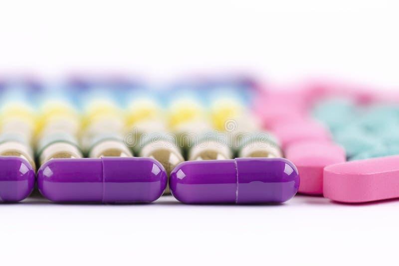 Haut étroit de capsules pourpres image libre de droits