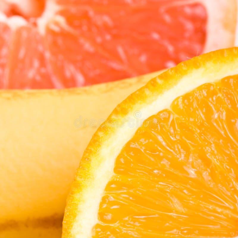 Haut proche d'orange, de pamplemousse et de banane photo stock