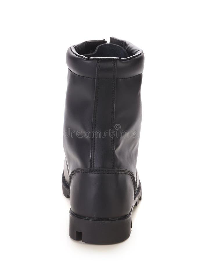 Haute botte en cuir noire. images libres de droits