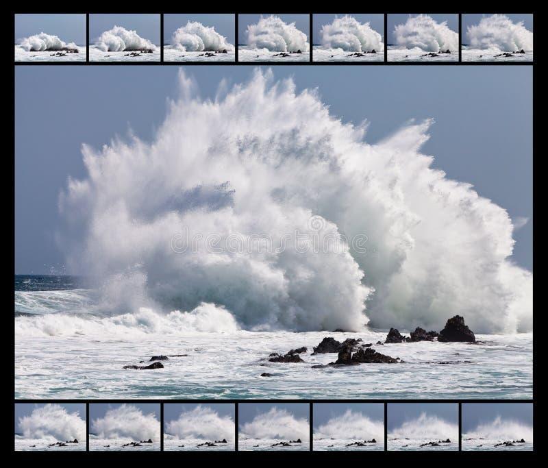 Haute onde se cassant sur les roches image libre de droits