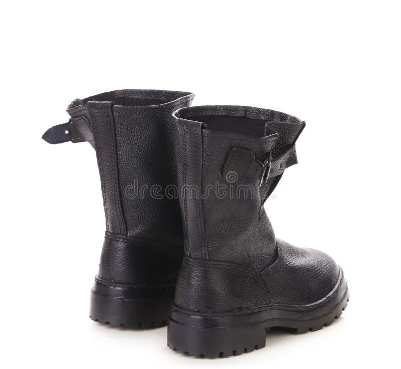 Hautes bottes en cuir noires photo libre de droits