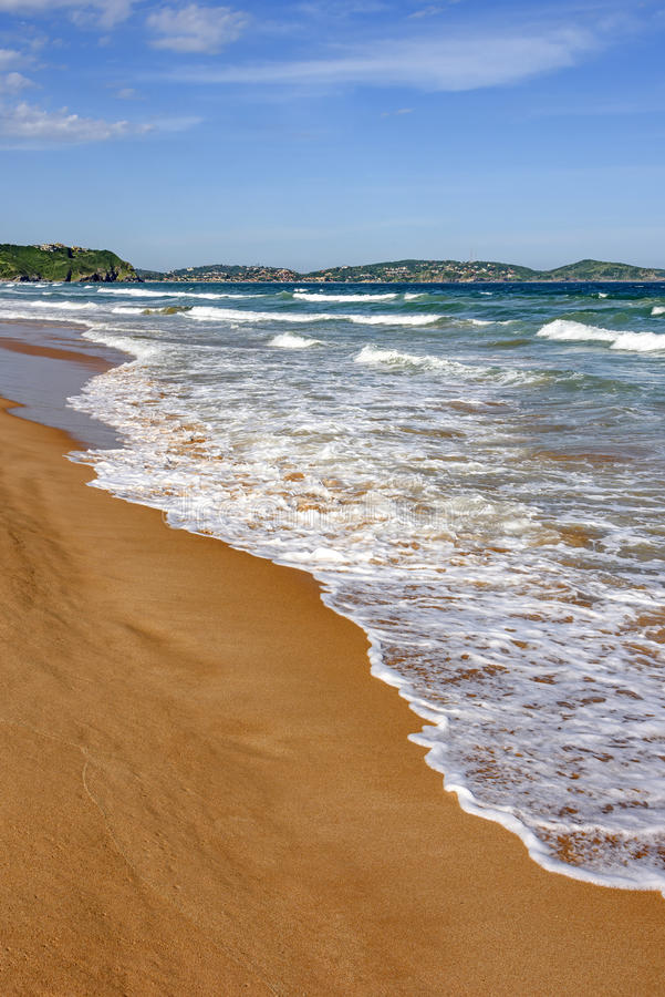 Hav och sand arkivbild