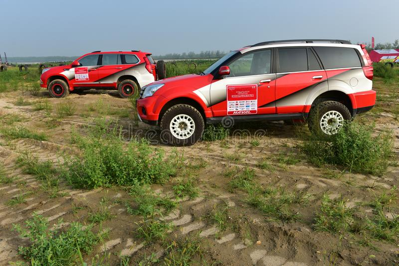 HAVAL H5 and H9 off-road vehicle in the sand royalty free stock photos