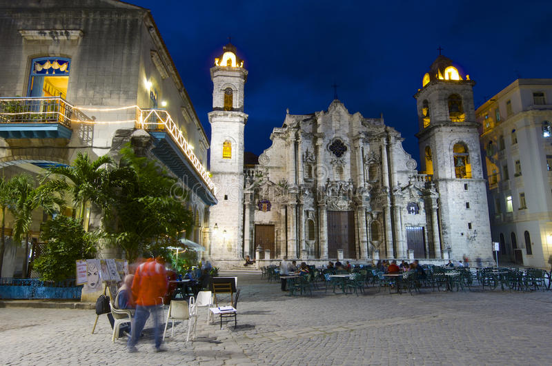 Havana. Cuba - January 28, 2007: street scene in the cathedral square, stands the Cathedral of San Cristobal. This is a typical place frequented by visiting royalty free stock photos