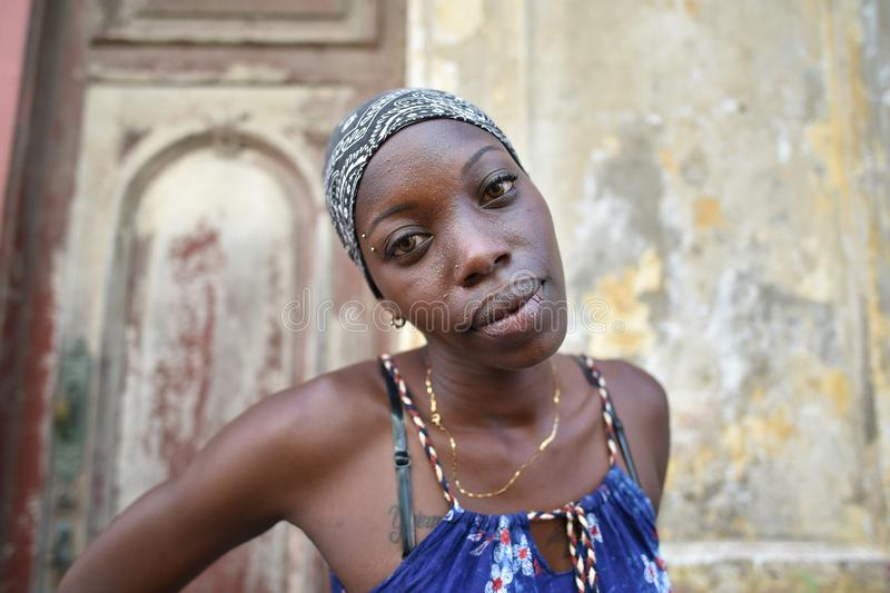 Havana, Cuba, August 14th, 2018: Cuban girl posing at her home in Havana royalty free stock photos