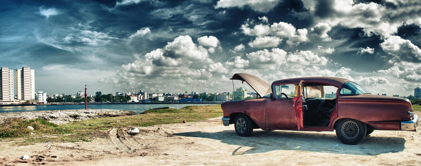 HAVANA, CUBA- DEC 12, 2016: panoramic view of havana and malecon with old american car parked whit engine ploblem stock photo