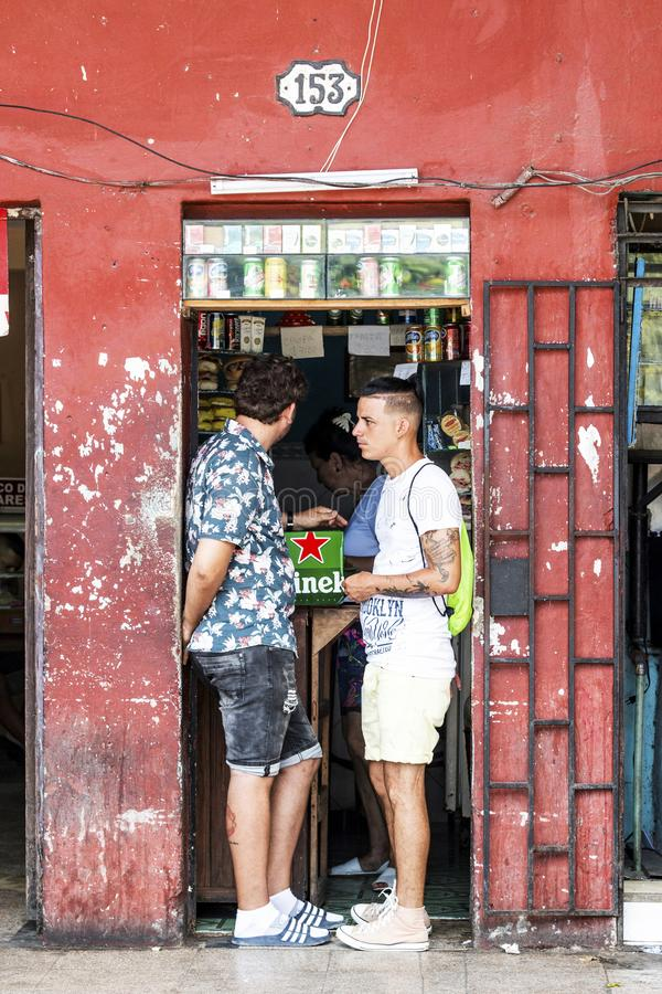 Two men in doorway of store in Cuba stock photo