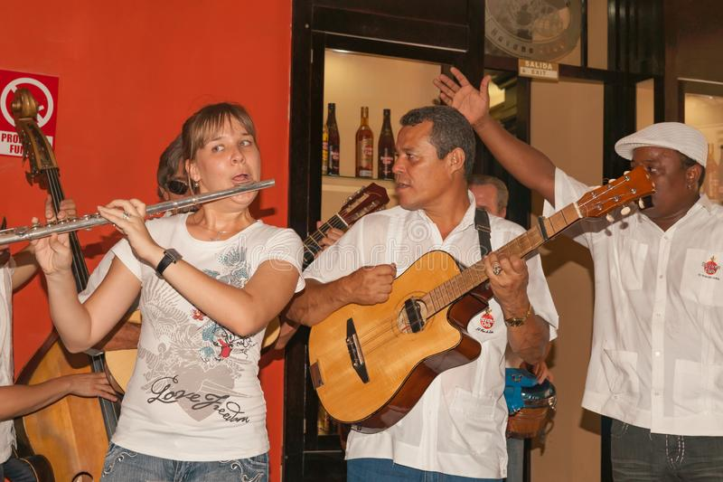 Musicians perform in bar stock photo
