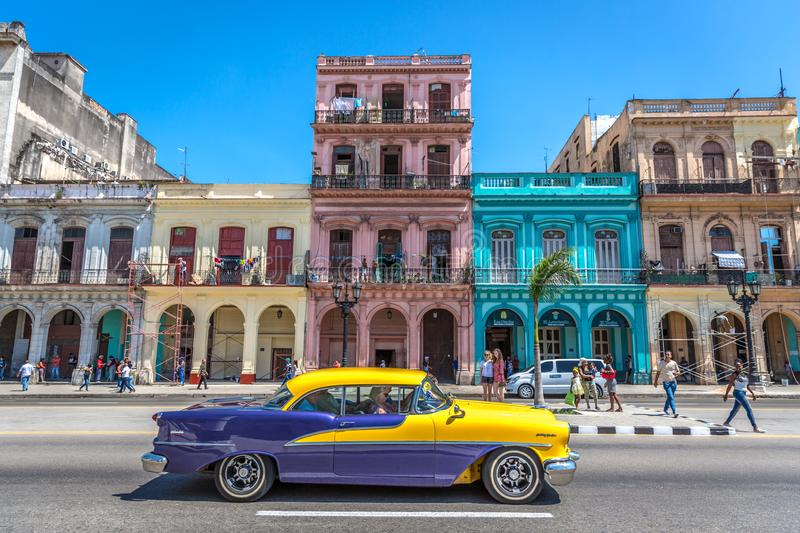 Havana, Cuba - Mar 10th 2018 - Classic image of Havana, with color everywhere, old cars in the street, people around, colonial hou royalty free stock image