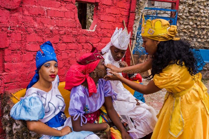 Santeria Dance Performers - Callejon de Hamel / Hamel Alley. Havana, Cuba / March 20, 2016: Costumed Cuban women fixing makeup before Santeria performance at stock images