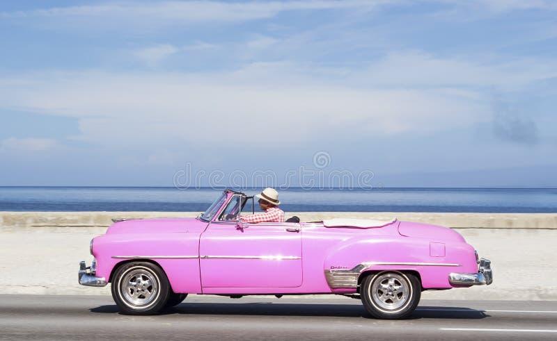 HAVANA,CUBA - NOVEMBER 9, 2015 : Vintage american car at the Malecon avenue stock photo