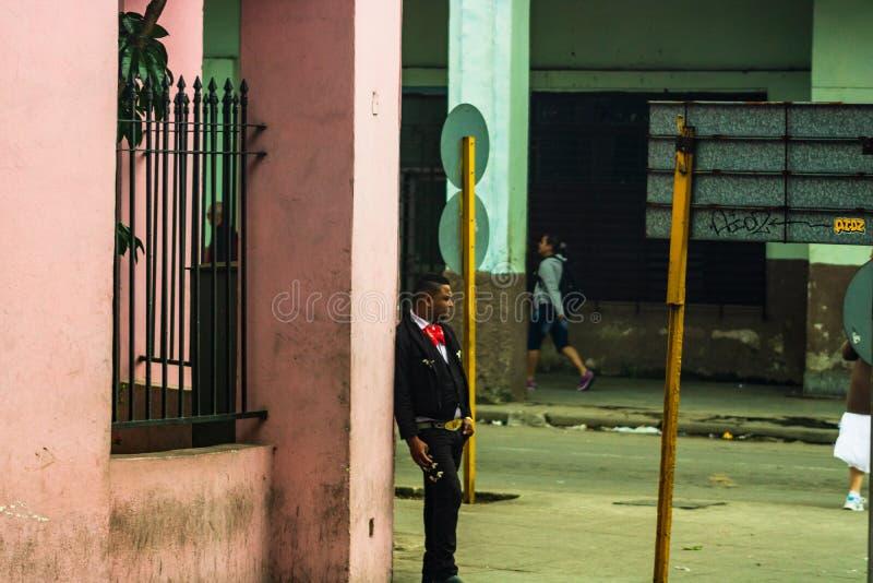 Havana, Cuba – 2019. Young Cuban man waiting on the street corner royalty free stock photos