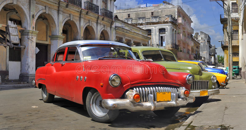 Havana street with colorful old cars in a raw royalty free stock images