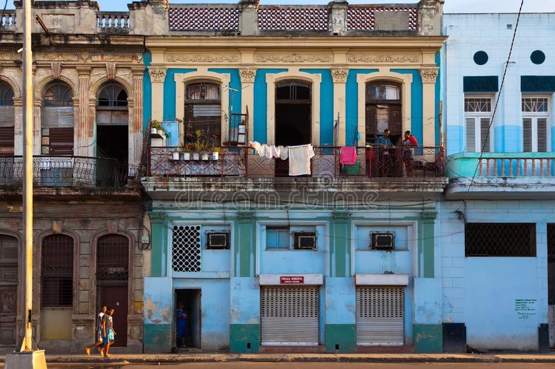 Havana street in district Serrra. Color-rich house and unknown residents. Sunset stock image