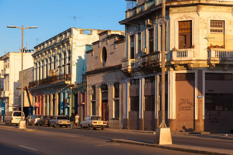 Havana street in district Serrra. Color-rich house and unknown residents. Sunset royalty free stock photo