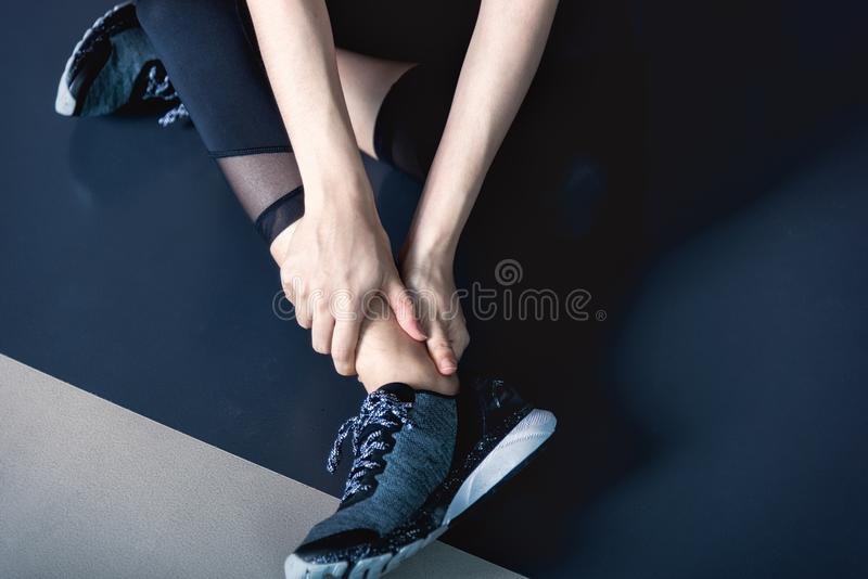 Have ankle cramp in fitness exercise training in gym. Young woman have ankle cramp in fitness exercise training in fitness gym stock images