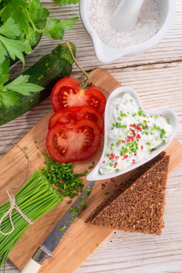 Have breakfast curd with chives. A have breakfast curd with chives stock photography