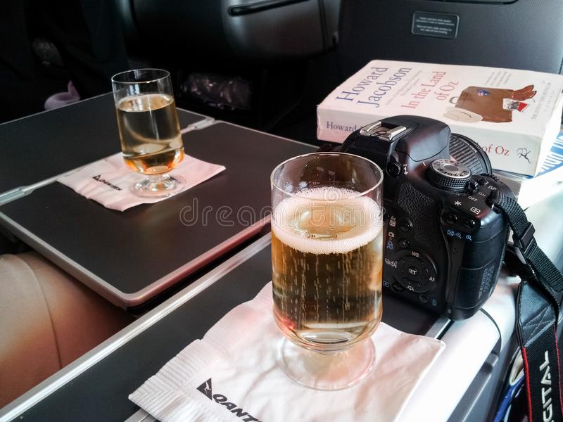 Have camera will travel - settled into business class on Quantas with wine a camera and a good book Los Angeles CA USA 11 24 2013 stock images