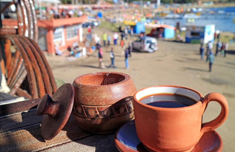 Have a cup of coffee at the outdoor terrace on upper floor of waterfront cafe, Lake Titicaca shore, Copacabana, Bolivia stock photography