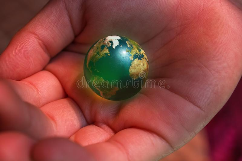 We Have the Earth on our Hands royalty free stock photos