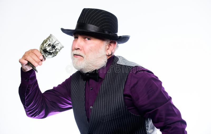 Have a fright. halloween holiday costume. barman make cocktail for halloween party. mature man magician in witch hat royalty free stock photos