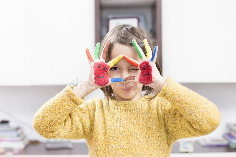 Little girl have fun with colored hand stock photography