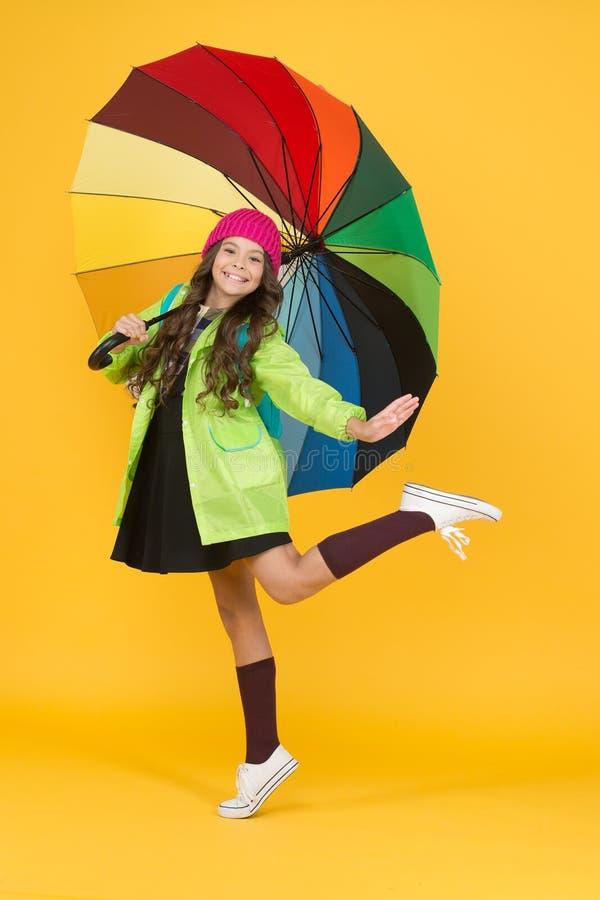 Have fun. Positivity concept. Rainy day fun. Happy walk under umbrella. Enjoy rain concept. Kid girl happy hold colorful royalty free stock photography