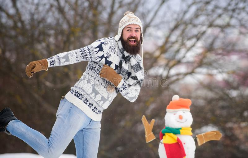 Have fun winter day. Let it snow. Christmas holidays. Active lifestyle. Snow games. Leisure on fresh air. Man cheerful. Bearded hipster knitted hat and warm royalty free stock photos