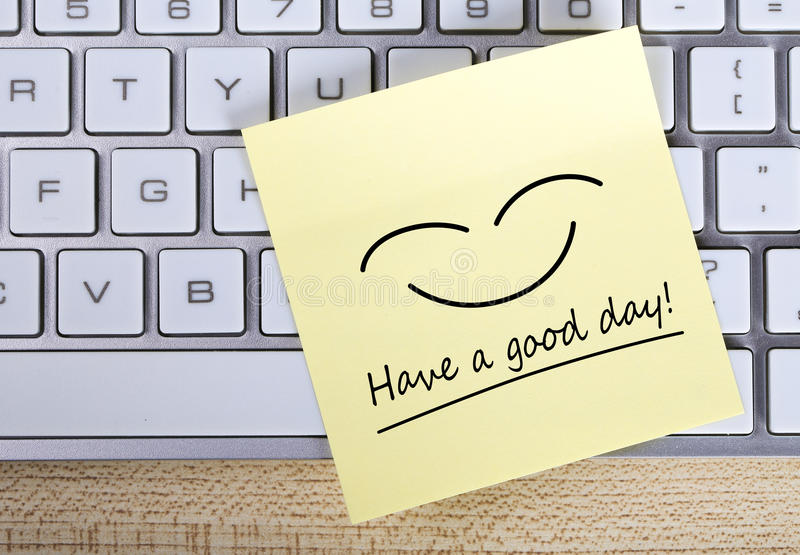 Have a good day Note. Top view of Have a good day sticky note pasted on the keyboard stock photography
