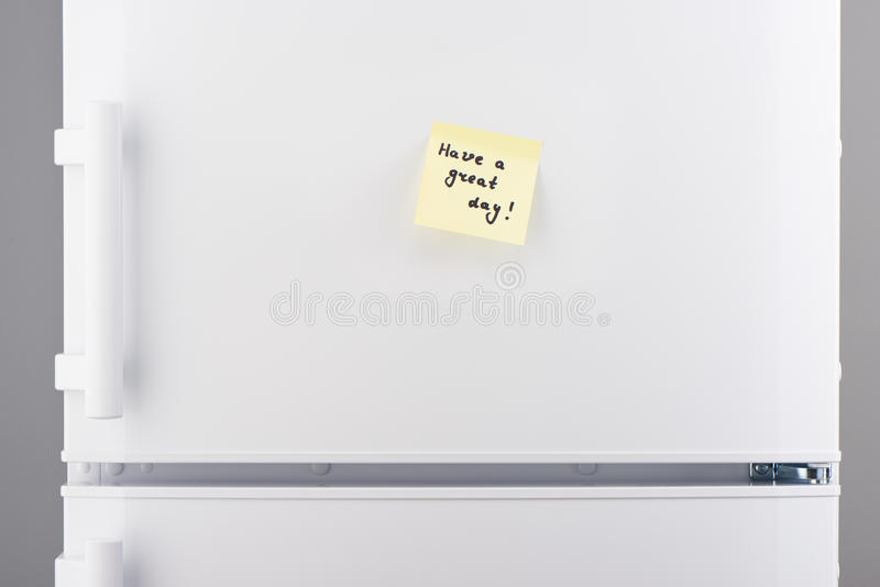 Have a great day note on light yellow sticky paper stock images