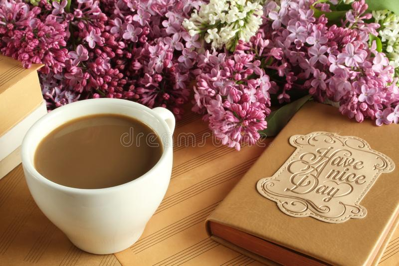 Have a nice day. Morning coffee with milk and a notebook with the wishes of a good day stock photography