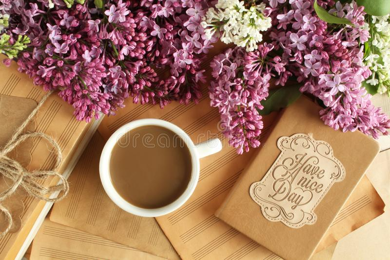 Have a nice day. Morning coffee with milk and a notebook with the wishes of a good day royalty free stock images