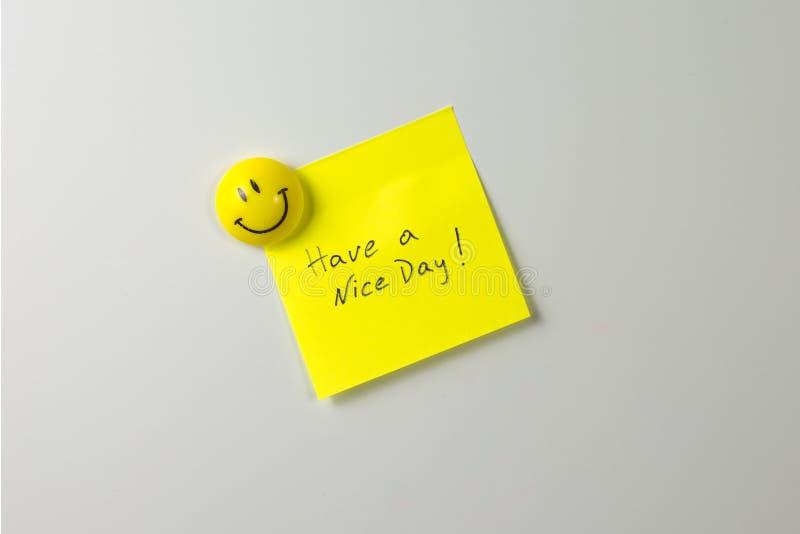 smiling magnet on a white fridge royalty free stock image