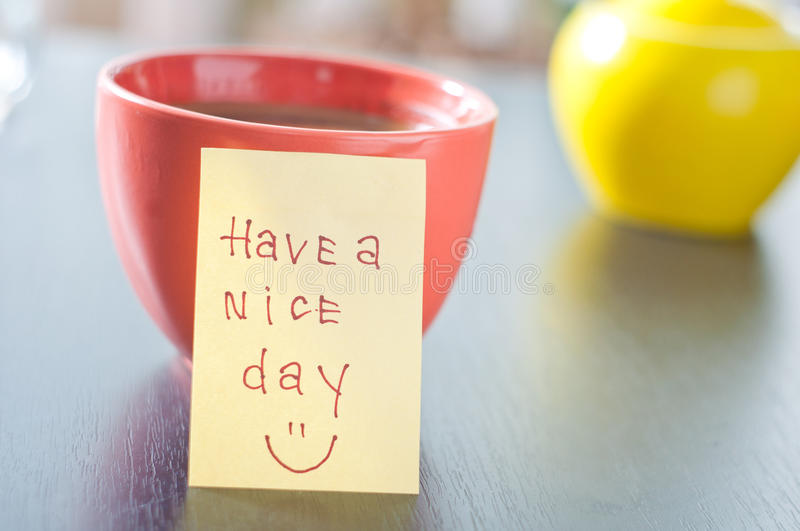 Have a nice day with smile and cup coffe stock photography