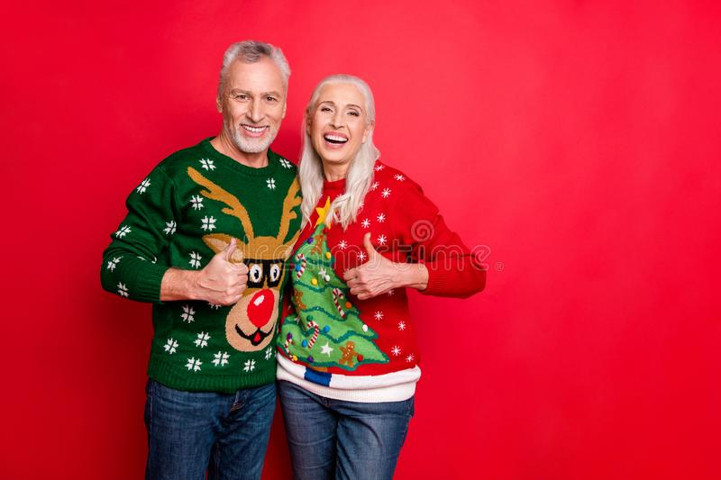 We have perfect style concept. Photo of cheerful cool cheerful excited granddad and granny making finger up sign hugging stock photography