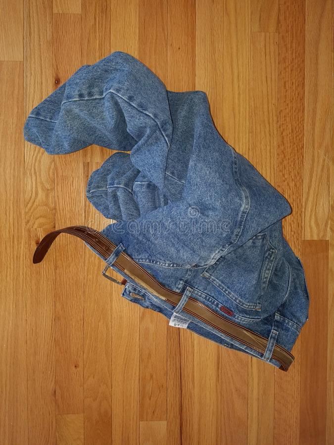 Blue jeans on a wooden floor royalty free stock image