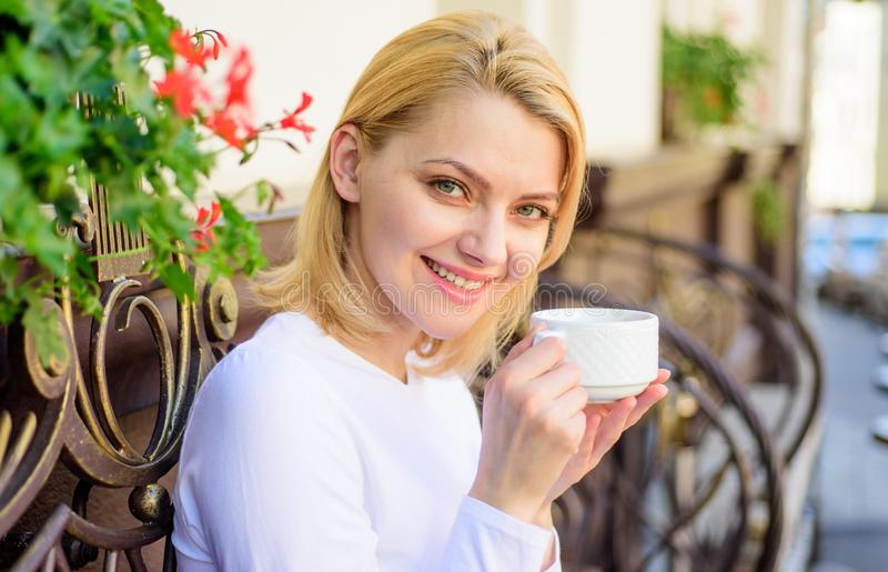 Have sip of hot aromatic beverage. Woman have drink cafe terrace outdoors. Mug of good coffee in morning gives me energy. Charge. Girl drink coffee every royalty free stock image