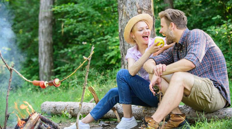 Have snack. Couple relaxing sit on log having snacks. Family enjoy romantic weekend in nature. Picnic roasting food over royalty free stock photo