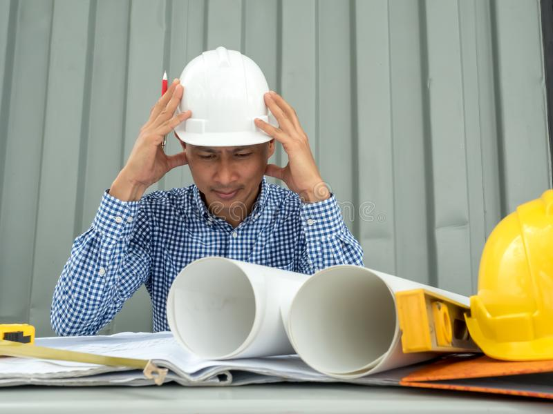 Have stress, Asia Engineer serious thinking, young man and looking away while sitting royalty free stock photography