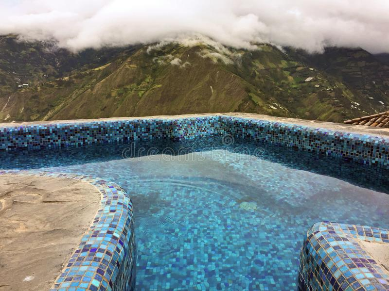 POOLSIDE OVERLOOKING ANDES MOUNTAINS, BANOS ECUADOR. Have a swim with breathtaking views of the Andes mountains from the pool at Luna RunTun royalty free stock photography