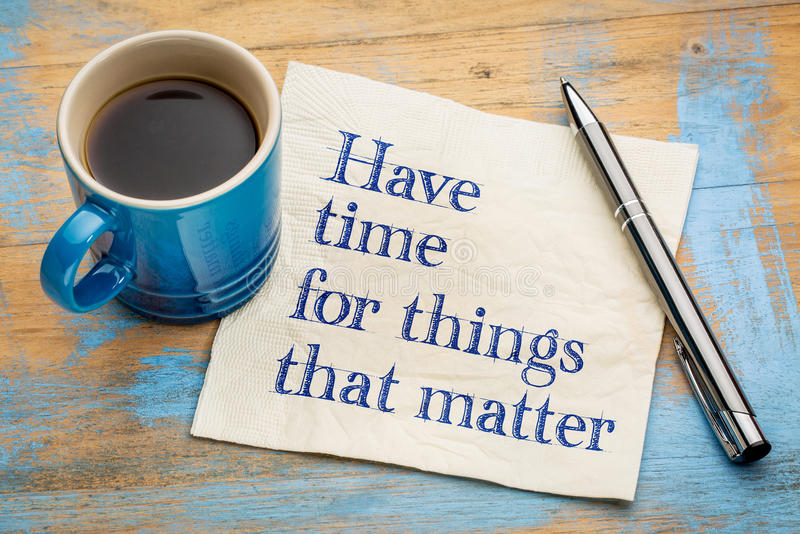 Have time for things that matter. Handwriting on a napkin with a cup of espresso coffee stock image