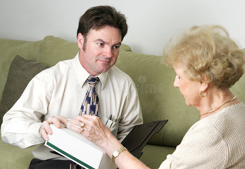 Sympathetic Health Care Employee Looking At You Stock