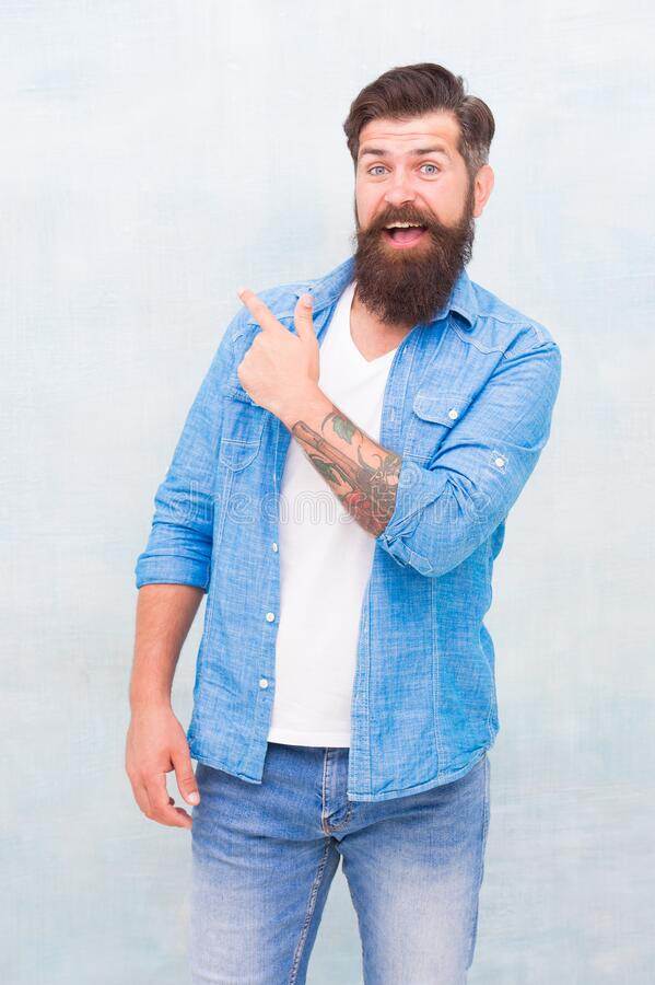 Free Have You Seen This. Shopping Promotion. Items For Men. Good Looking Guy. Cheerful Hipster. Promoting Goods. Handsome Man Royalty Free Stock Photo - 183215165