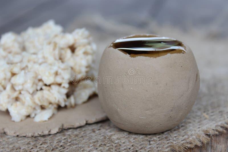 Havermeel en natuurlijke honing stock afbeeldingen