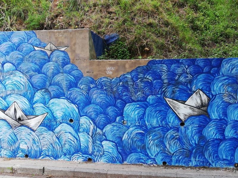 Havet som målas av gatakonstnären, kan vara så härligt som verklig arkivbilder