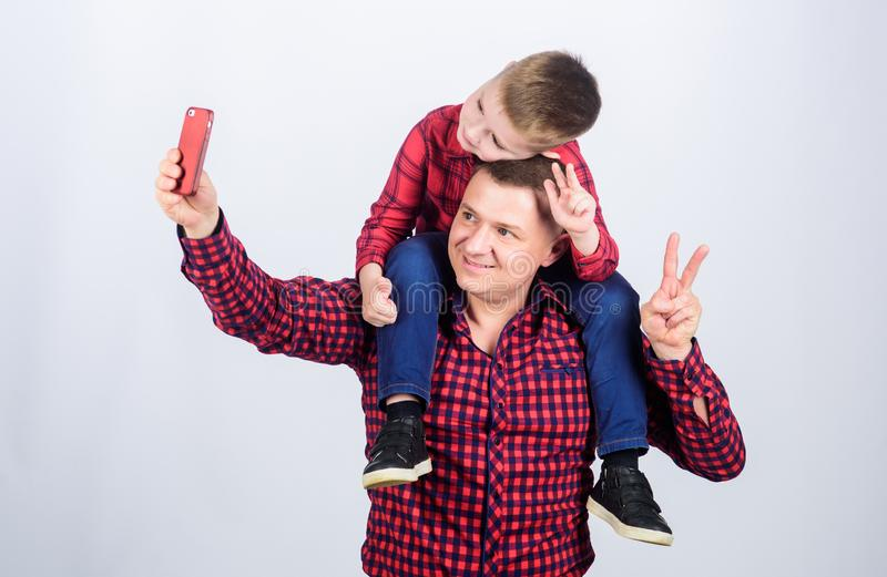 Havinf fun together. selfie. childhood. parenting. fathers day. Enjoying time together. Happy family together. father. And son in red checkered shirt. small boy stock images