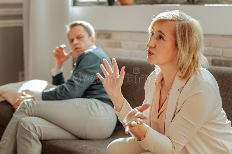 Expressive angry woman actively gesturing while explaining her discontentment. Having an argument. Expressive angry women actively gesturing while explaining her stock image
