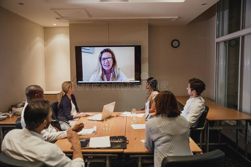 Video Call at the Conference. Having a business meeting with a video call late after work. Working late in the office royalty free stock photography