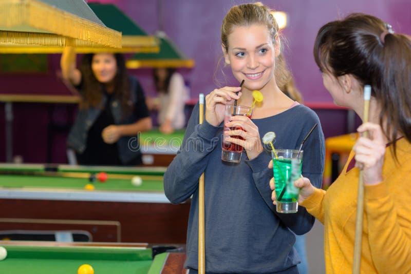 Having drink in billiards hall stock image